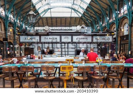 LONDON - MAY 21: pizzeria Union Jacks in Covent Garden Market with unidentified people on May 21, 2014 in London, by Americas premier pizzamaker Chris Bianco and British celebrity chef Jamie Oliver - stock photo