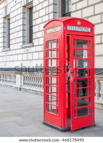 LONDON - MAY 24: Red telephone booth is one of symbol of London, located on pathway along Parliament street in London, England, was taken on May 24, 2016.
