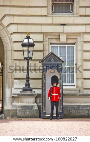 LONDON - MAY 12: Sentry of the Grenadier Guards posted outside of Buckingham Palace on May 12, 2011 in London, UK. The soldiers are charged with guarding the official royal residences in London.