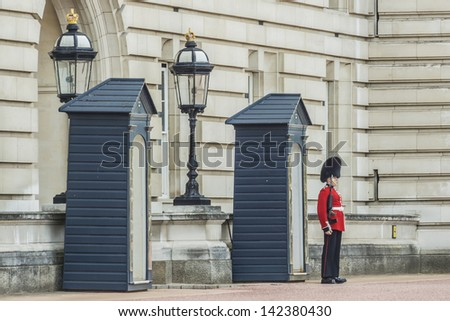 LONDON - MAY 30: Sentry of the Grenadier Guards posted outside of Buckingham Palace on May 30, 2013 in London, UK. Grenadier Guards was organized back in 1656.