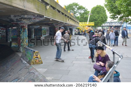 LONDON - MAY 31, 2014: Skateboarders use the undercroft at the Southbank. Hailed as the birthplace of British skateboarding it is now under threat of closure. - stock photo