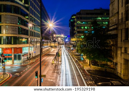 LONDON - MAY 26 : Southwark riverside, pictured at night on May 26th, 2014, in London, UK. Charles Dickens set several of his novels here where he lived as a young man.  - stock photo