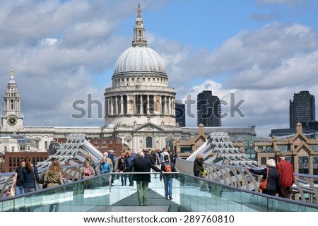 LONDON - MAY 12 2015:St Pauls Cathedral as view from Millennium Bridge.The cathedral is one of the most famous and recognizable sights of London, with its dome dominating the skyline for 300 years - stock photo