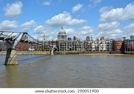 LONDON - MAY 12 2015:St Pauls Cathedral the and Millennium Bridge, London UK.The Millennium Bridge was London first new Thames crossing in more than 100 years, since Tower Bridge was opened in 1894. - stock photo