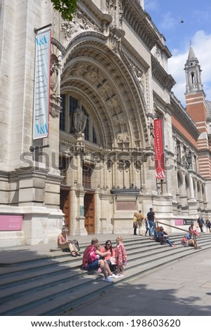 LONDON - MAY 31, 2014: The entrance to the Victoria and Albert Museum in London. The Victoria and Albert Museum houses a permanent collection of over 4.5 million objects and pieces of art. - stock photo