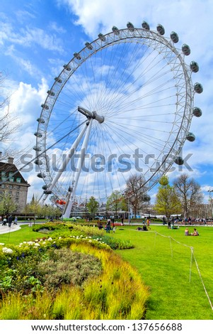LONDON - MAY 5 : The London Eye Ferris wheel pictured on May 5th, 2013, in London, UK. Built in 1999, 135m tall and with a wheel diameter  of 120m, it is the tallest Ferris wheel in Europe. - stock photo