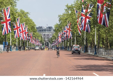 LONDON - MAY 31: The Mall is decorated with Union Jack flags to celebrate 60th Anniversary of Coronation of Britain's Queen Elizabethm II, on May 31, 2013 in London, England. - stock photo