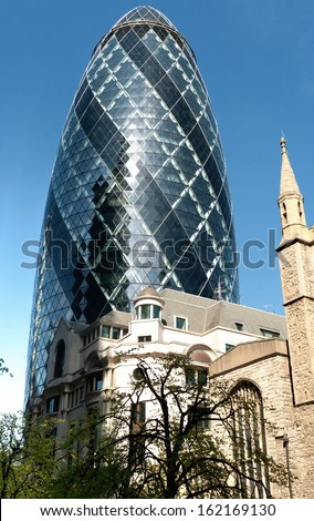 LONDON - MAY 25: The modern glass buildings of the Swiss Re Gherkin on May 25, 2011 in London, England. This tower is 180 meters tall and stands near Liverpool Street Station in City of London. - stock photo
