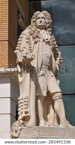 LONDON - MAY 26, 2015. The statue of Sir Hans Sloane (1660-1753) a British physician noted for bequeathing his collection to form the British Museum; located in the Physic Garden, Chelsea, London, UK.