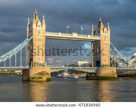 LONDON - MAY 24: The Tower Bridge, one of the most famous in UK, cross river Thames in London, England, on May 24, 2016.