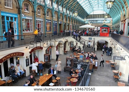 LONDON - MAY 15: Tourists visit Apple Market on May 15, 2012 in Covent Garden, London. According to TripAdvisor, Camden Town currently is one of top 5 shopping destinations in London. - stock photo