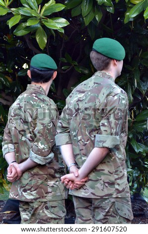 LONDON - MAY 14 2015:Two 29th Commando Regiment Royal Artillery soldiers.The spearhead troops trained as amphibious, mountain and arctic warfare specialists also can operate in the desert or jungle. - stock photo