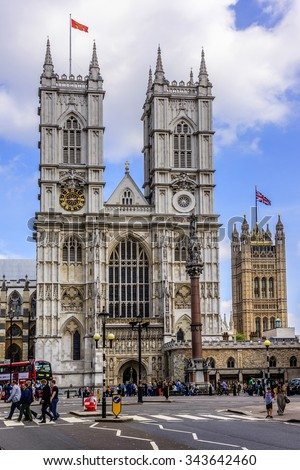 LONDON - MAY 31, 2013: View of front side of Westminster Abbey (Collegiate Church of St Peter at Westminster). Westminster - traditional place of coronation of English monarchs. - stock photo
