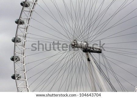 LONDON-MAY 16:View of The London Eye on May 16, 2010 in London, England.A famous tourist attraction at a height of 135 meters (443 ft) and the biggest Ferris wheel in Europe - stock photo