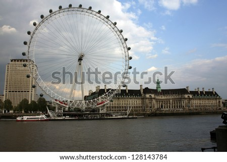 LONDON-MAY 13:View of The London Eye on May 13, 2010 in London, England.A famous tourist attraction at a height of 135 meters (443 ft) and the biggest Ferris wheel in Europe - stock photo