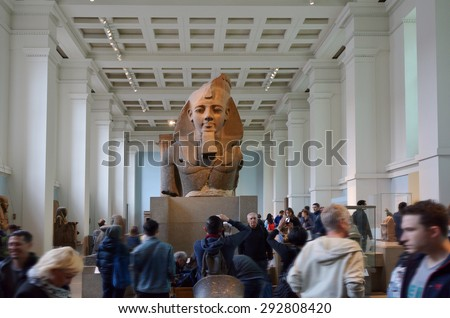 LONDON - MAY 15 2015:Visitors in the British Museum.The Museum contain almost 71,000 books, manuscripts, drawings, prints and antiques taken from Greece, Rome, Egypt, and many different countries. - stock photo