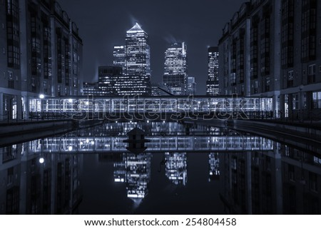 London modern finance district in downtown illuminated at night. - stock photo