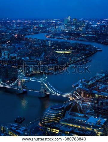 London Night Looking East Toward Tower Bridge, River Thames, Canary Wharf. - stock photo