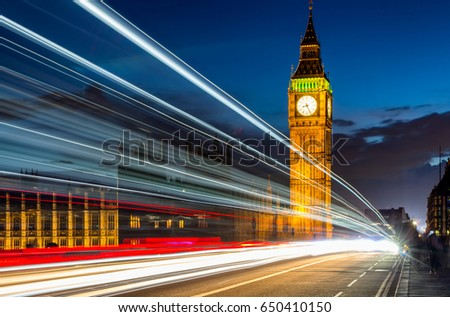 London Night View, Palace of Westminster and Big Ben at dawn with blurred motion of traffic lights. London, England