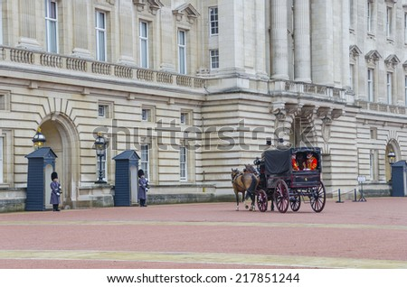 LONDON - NOV 28: changing of the guard in Buckingham Palace, on November 28, 2013 in London, Great Britain - stock photo