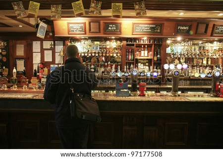 LONDON - NOV 04: Interior of pub, for drinking and socializing, focal point of the community, on Nov 04, 2010, London, UK. Pub business, now about 53,500 pubs in the UK, has been declining every year - stock photo