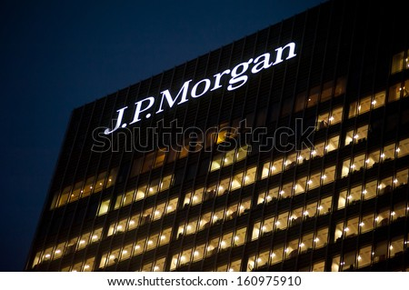 LONDON - NOV 1: J.P. Morgan offices in Canary Wharf in London on November 1, 2013. Full-time employees in the UK work longer hours than the EU average, according to the Office for National Statistics. - stock photo