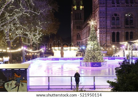 LONDON - NOV 7 : Night View of National History Museum Icr Rink on Nov 7; 2016; London; UK. Ice-skating people beating the winter cold at the famous Natural History Museum's annual Ice Rink .