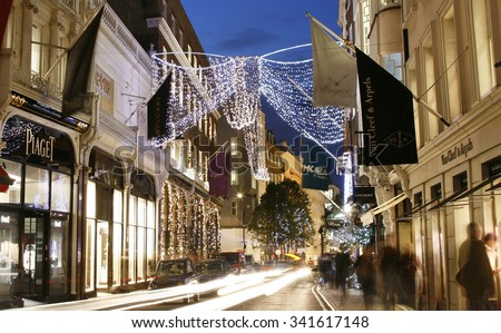 LONDON - NOV 18 : Street Night View of Bond Street with Christmas Decoration on Nov 18, 2011, London, UK. Bond Street is one of the most famous luxury shopping street in London.  - stock photo
