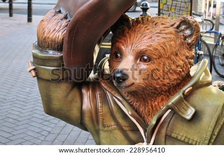 LONDON - NOVEMBER 4. A decorated street model of Michael Bond's fictional character Paddington Bear, on November 4, 2014, for later charity auction; one of 50 designs located across London. - stock photo
