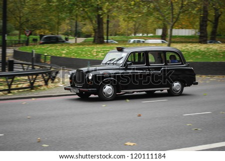 LONDON - NOVEMBER 9 : A London Taxi or 'Black Cab' in Park Lane on November 9, 2012 in London, UK. All London cabs undergo a strict annual mechanical test before they are allowed to ply for hire. - stock photo