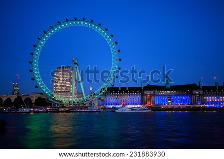 LONDON-NOVEMBER 5: London Eye at sunset on November 5, 2014 in London. London Eye is tallest Ferries wheel in Europe which attract over 3.5 million visitors annually. - stock photo