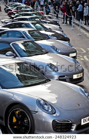 LONDON - NOVEMBER 1: Members of the Porsche owners club line their vehicles along Regent street on public display at the annual Regent street motor show on November 1, 2014 in London