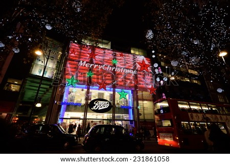 LONDON-NOVEMBER 17: Oxford Street at night on November 17,2014 in London. Light decoration in central London as part of preparation for the Christmas and New Year celebration. - stock photo