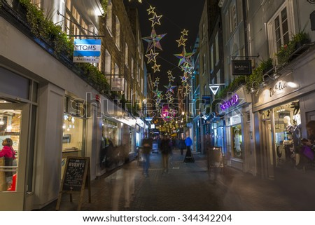 LONDON - NOVEMBER 26th 2015: Christmas lights on Carnaby Street, London UK. The Christmas lights attract thousands of shoppers during the festive season and are a major tourist attraction in London