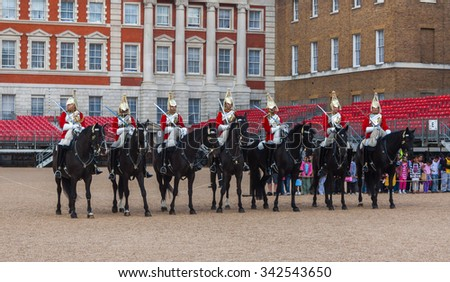 LONDON - November 02: Unidentified members of The Queen's Life Guard or Horse Guard participate in the changing ceremony in London, UK on November 02, 2014. Guard Mounting Ceremony is held daily. - stock photo