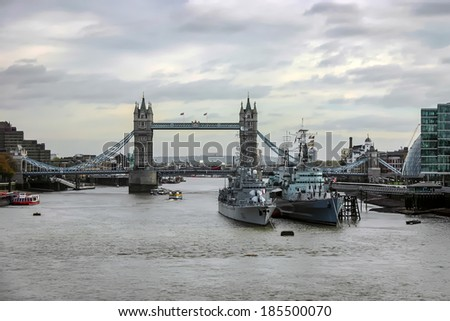 LONDON - NOVEMBER 17 : View of Tower Bridge and two warships in London on November 17, 2004