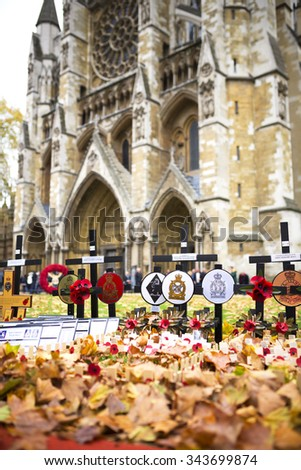 LONDON - NOVEMBER 8: Wooden crosses with poppies in Remembrance Day, Westminster Abbey in November 8, 2015 in London, UK. Crosses placed in Remembrance of those who lost their lives during the war. - stock photo