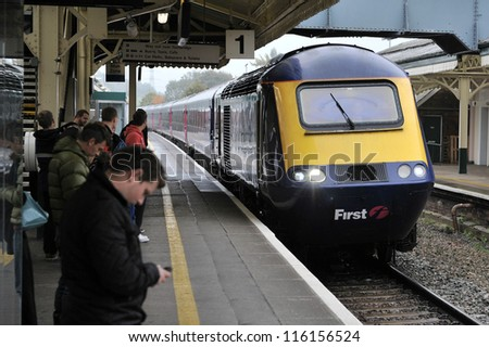 LONDON - OCT 8: A train pulls into Clapham Junction station on Oct 8, 2012 in London, UK. Clapham Junction station is one of the busiest in Europe with more than 100 trains per hour during peak times. - stock photo