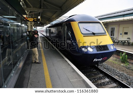 LONDON - OCT 8: A train pulls into Clapham Junction station on Oct 8, 2012 in London, UK. Clapham Junction station is one of the busiest in Europe with more than 100 trains per hour during peak times.