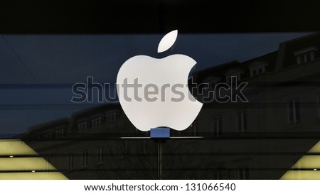 LONDON - OCT 4: Apple store logo on a store exterior in central London as the US technology giant launches the new iPhone 5 in the UK and Europe on Oct 4, 2012 in London, UK. - stock photo