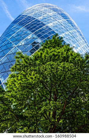 LONDON - OCT 3 : The modern Gherkin tower pictured on October 3rd, 2013, in London, UK. Known as the SwissRe Building (completed in 2003), Sky News broadcasts its flagship programme Jeff Randall Live. - stock photo