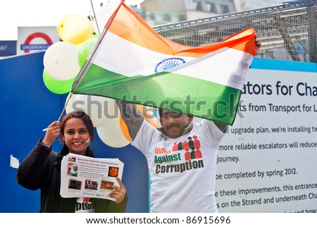 LONDON-OCTOBER 16: A peaceful demonstration against corruption in India held on the sidelines of the Diwali Festival of Light in Trafalgar Square on October 16, 2011 in London. - stock photo