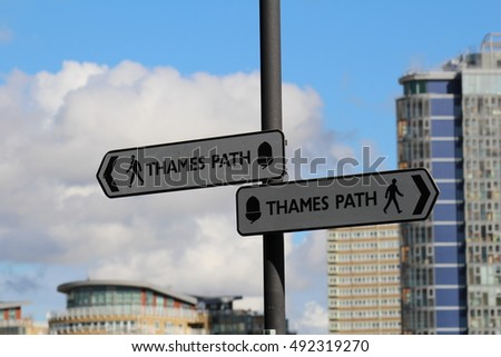 London, October 2016 A sign directs pedestrians along to the Thames Path, a protected public realm running along the River Thames