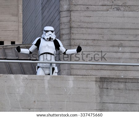 LONDON - OCTOBER 4, 2015.  A Stormtrooper, the fictional character from Stars Wars, on a concrete balcony at the National Theatre, the 1977 Brutalist building located at the Southbank, London, UK. - stock photo