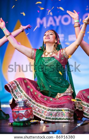 LONDON-OCTOBER 16: An unnamed female dancer performs the opening routine of the dance troupes act, at the Diwali Festival of Light at Trafalgar Square on October 16, 2011 in London - stock photo