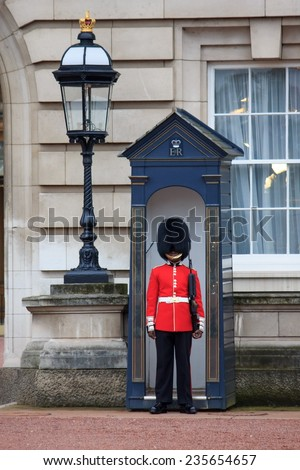 LONDON - OCTOBER 16: British Royal guards guard the entrance to Buckingham Palace on October 16, 2014 in London, UK