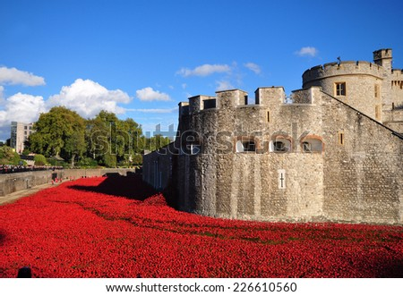 LONDON - OCTOBER 11. Ceramic poppies on October 11, 2014 commemorate the 888,246 British and colonial military who died in the 1914-1918 First World War, installed at the Tower of London. - stock photo