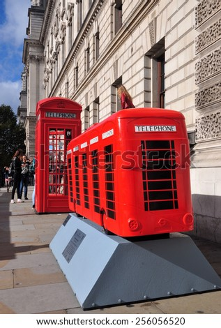 LONDON - OCTOBER 19. London celebrates its buses with decorative painted models on October 19, 2014; this one painted as a row of phone boxes by Stephen McKay in Parliament Square, London.