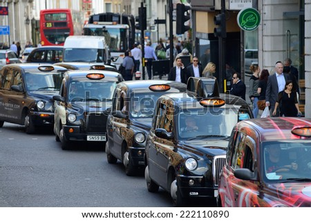 LONDON - OCTOBER 03: London Taxi on October 03, 2014 in London, UK. Traditionally Taxi cabs are all black in London but now produced in various colors. - stock photo