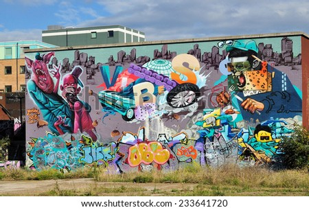 LONDON - OCTOBER 11. Painted street art entitled 'Meeting of Styles' on old brick building on October 11, 2014, located at Shoreditch in the Borough of Tower Hamlets, east London, UK. - stock photo